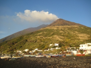Stromboli...those are not clouds, that's steam and other gasses coming out of the volcano.