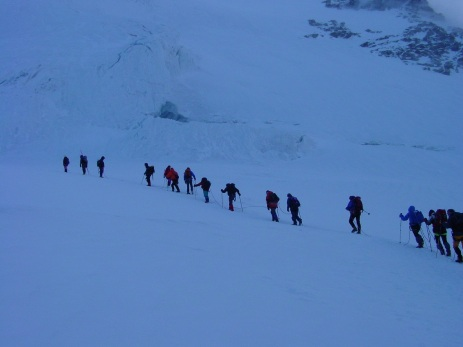 Trekkers heading up to the Rifugio Margherita before dawn