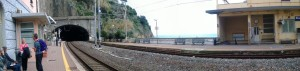 Riomaggiore train station with Australian in shortsleeves.